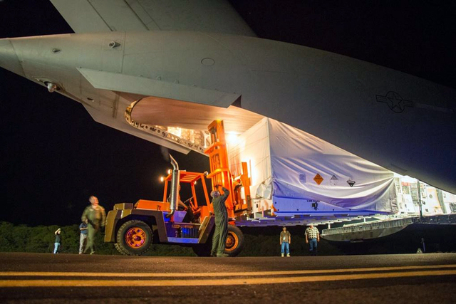 This April 17, 2014 image provided by NASA shows workmen unloading a saucer-shaped test vehicle for NASA's Low-Density Supersonic Decelerator (LDSD) project, at the U.S Navy's Pacific Missile Rang ...