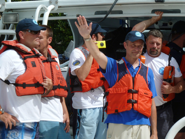Fabien Cousteau waves, on Sunday, June 1, 2014, from the boat ferrying him from Florida International University's Medina Aquarius Program headquarters in Islamorada, Fla., to the waters above Aqu ...