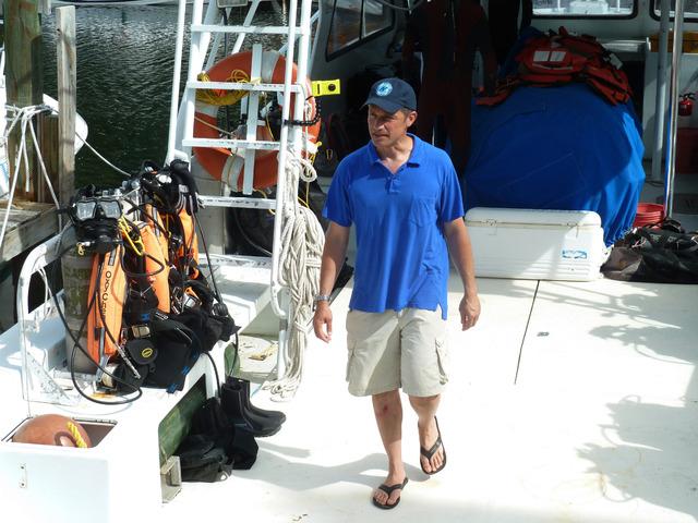 Fabien Cousteau walks, on Sunday, June 1, 2014, on the boat ferrying him from Florida International University's Medina Aquarius Program headquarters in Islamorada, Fla., to the waters above Aquar ...