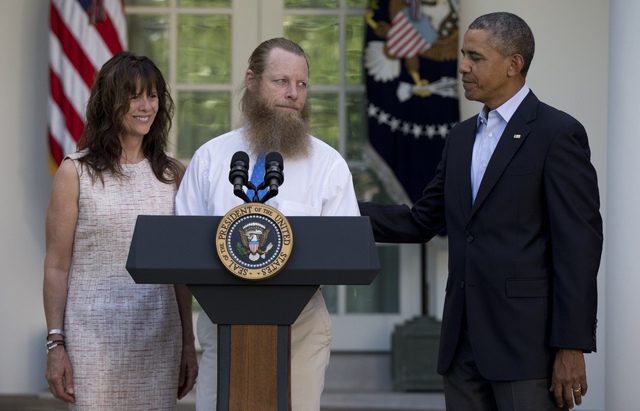 Accompanied by President Barack Obama, Jani Bergdahl and Bob Bergdahl speak during a news conference in the Rose Garden of the White House in Washington on Saturday, May 31, 2014 about the release ...
