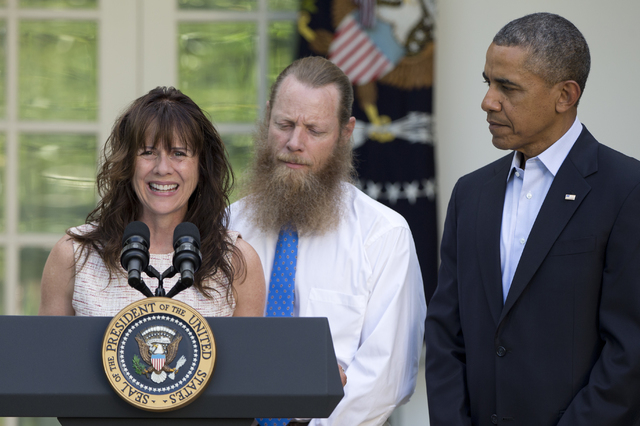 Accompanied by President Barack Obama, Jani Bergdahl, and Bob Bergdahl speak during a news conference in the Rose Garden of the White House in Washington on Saturday, May 31, 2014 about the releas ...