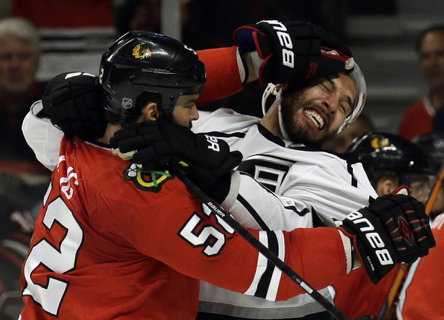 Chicago Blackhawks left wing Brandon Bollig (52) and Los Angeles Kings left wing Dwight King (74) fight during the first period in Game 7 of the Western Conference finals in the NHL hockey Stanley ...