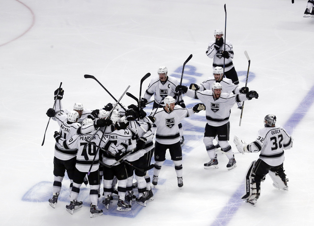 Los Angeles Kings celebrate after defeating Chicago Blackhawks 5-2 in the overtime period in Game 7 of the Western Conference finals in the NHL hockey Stanley Cup playoffs Sunday, June 1, 2014, in ...