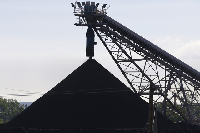 A hill of coal is seen at the North Omaha Station, a coal-burning power station, in Omaha, Neb., Monday, June 2, 2014. The Obama administration on Monday unveiled a plan to cut earth-warming pollu ...