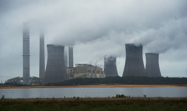 The coal-fired Plant Scherer is shown in operation early Sunday, June 1, 2014, in Juliette, Ga. The Obama administration unveiled a plan Monday to cut carbon dioxide emissions from power plants by ...