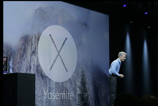 Apple senior vice president of Software Engineering Craig Federighi introduces the Yosemite operating system during the Apple Worldwide Developers Conference in San Francisco, Monday, June 2, 2014 ...