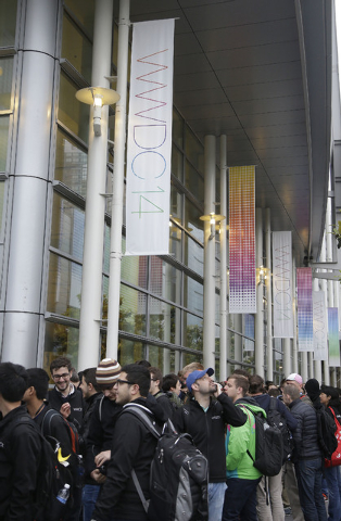 A crowd lines up before the Apple World Wide Developers Conference 2014 at the Moscone Center in San Francisco, Monday, June 2, 2014. This week should provide a better sense of whether Apple is he ...