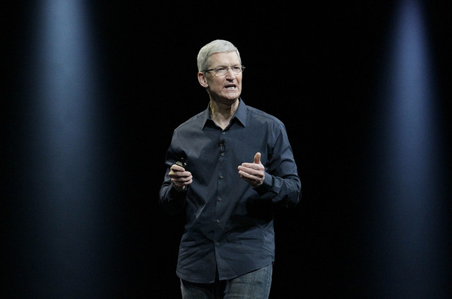 Apple CEO Tim Cook speaks at the Apple Worldwide Developers Conference event in San Francisco, Monday, June 2, 2014. (AP Photo/Jeff Chiu)