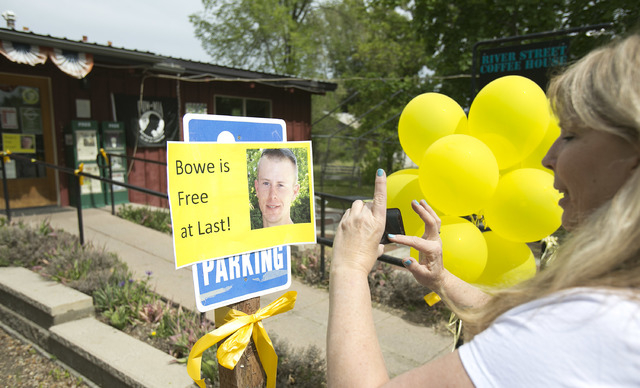 Diane Walker takes a picture of a sign celebrating U.S. Army Sgt. Bowe Bergdahl's release in front of Zaney's coffee shop in Hailey, Idaho. Bergdahl, 28, had been held prisoner by the Taliban sinc ...