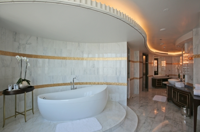 This May 19, 2014 photo shows the master bathroom in the Abu Dhabi Suite at the St. Regis in Abu Dhabi, United Arab Emirates. The 2,200 square meter two-story suite, which sells for a nightly rate ...