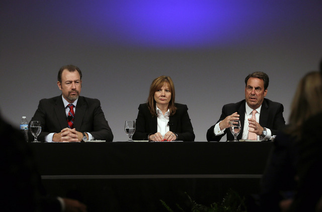 General Motors President Dan Ammann, left, CEO Mary Barra, and Executive Vice President Mark Reuss, hold a press conference at the General Motors Technical Center in Warren, Mich., Thursday, June  ...