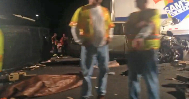 In this image from video the limousine bus carrying Tracy Morgan and six other people lies on it's side, left, as emergency responders work the accident scene early Saturday morning June 7, 2014 o ...