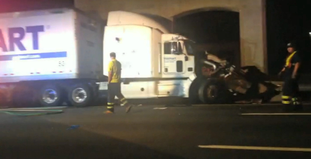 In this image from video the Wal-Mart truck involved in the crash of the limousine bus carrying Tracy Morgan and six other people is seen early Saturday morning June 7, 2014 on the New Jersey Turn ...
