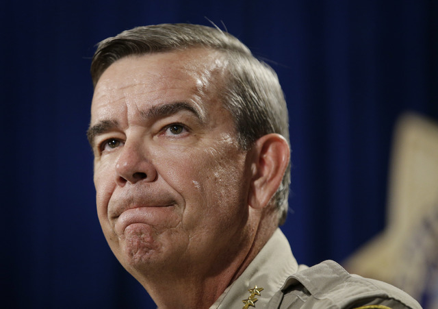 Sheriff Doug Gillespie speaks at a news conference on the shooting of two Las Vegas Metropolitan Police Department officers Sunday, June 8, 2014 in Las Vegas. (AP Photo/John Locher)