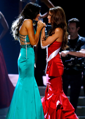 Miss North Dakota USA Audra Mari, left, and Miss Nevada USA Nia Sanchez await the final decision during the Miss USA 2014 pageant in Baton Rouge, La., Sunday, June 8, 2014. Sanchez would go on to  ...