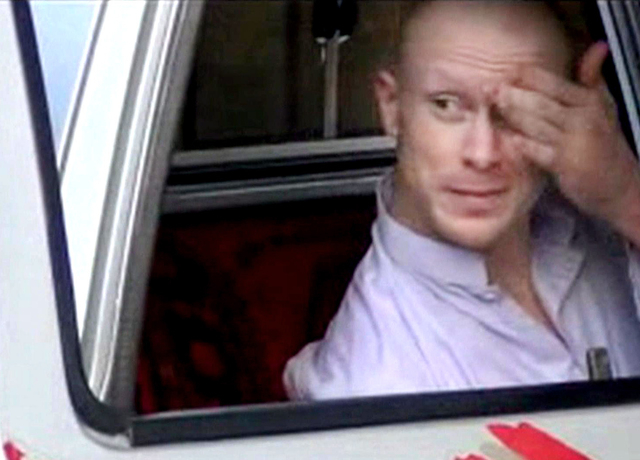 In this file image taken from video obtained from Voice Of Jihad Website, which has been authenticated based on its contents and other AP reporting, Sgt. Bowe Bergdahl, sits in a vehicle guarded b ...