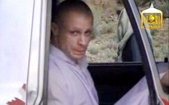 In this image taken from video obtained from Voice Of Jihad Website, which has been authenticated based on its contents and other AP reporting, Sgt. Bowe Bergdahl sits in a vehicle guarded by the  ...