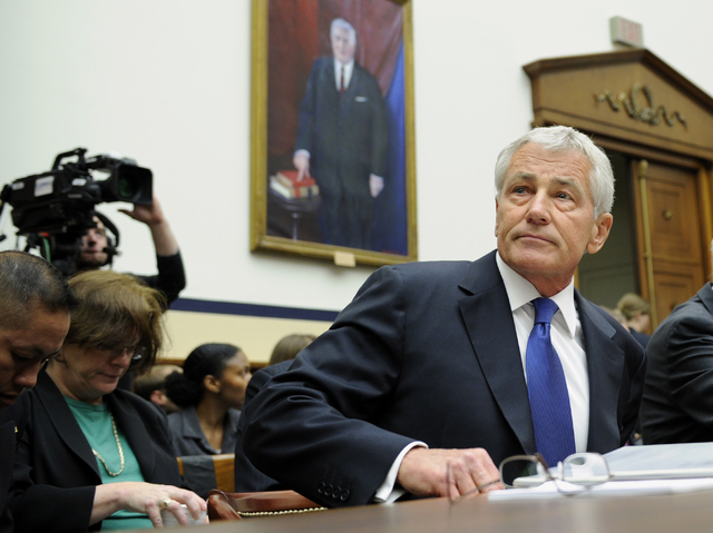 Defense Secretary Chuck Hagel arrives on Capitol Hill in Washington, Wednesday, June 11, 2014, to testify before the House Armed Services Committee. Hagel faced angry lawmakers becoming the first  ...
