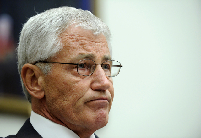Defense Secretary Chuck Hagel listens while testifying on Capitol Hill in Washington, Wednesday, June 11, 2014, before the House Armed Services Committee. Hagel faced angry lawmakers becoming the  ...