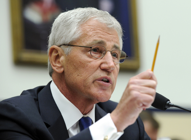Defense Secretary Chuck Hagel testifies on Capitol Hill in Washington, Wednesday, June 11, 2014, before the House Armed Services Committee. Hagel faced angry lawmakers becoming the first Obama adm ...