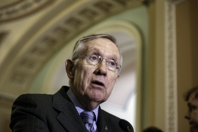 Senate Majority Leader Harry Reid of Nev. speaks to reporters on Capitol Hill in Washington, Tuesday, June 10, 2014, after a Democratic caucus lunch. Responding to the public outcry over lax care  ...