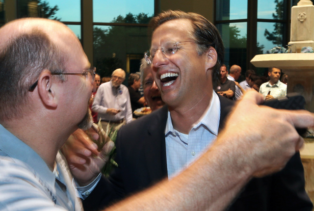 Dave Brat, right, is congratulated by Johnny Wetlaufer after Brat defeated House Majority Leader Eric Cantor in the Republican primary, Tuesday, June 10, 2014, in Richmond, Va. (AP Photo/Richmond  ...