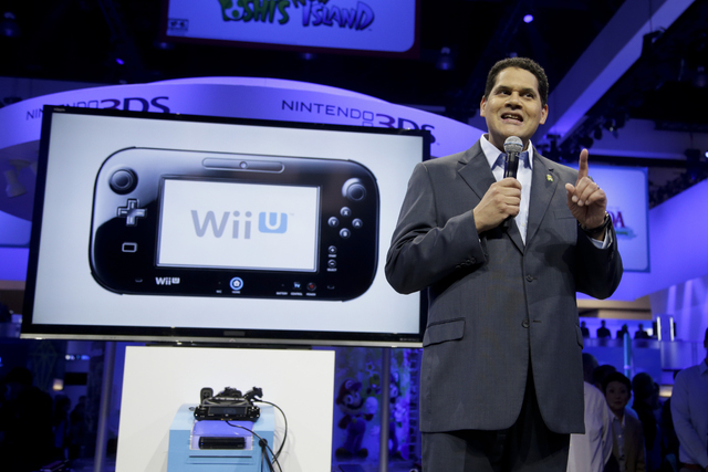 FILE - In this June 11, 2013 file photo, Reggie Fils-Aime, President and chief operating officer of Nintendo of America, addresses the media at the Nintendo Wii U software showcase during the E3 g ...