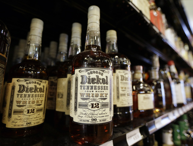 Bottles of George Dickel Tennessee whiskey are displayed in a liquor store Tuesday, June 10, 2014, in Nashville, Tenn. Alcohol regulators ended their investigation into whether George Dickel, a su ...