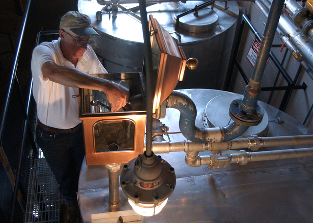 FILE -- In this Sept. 2003 file photo, Gary Hinshaw tests the proof of the whiskey at the George Dickel Distillery near Tullahoma, Tenn. Alcohol regulators ended their investigation Tuesday, June  ...