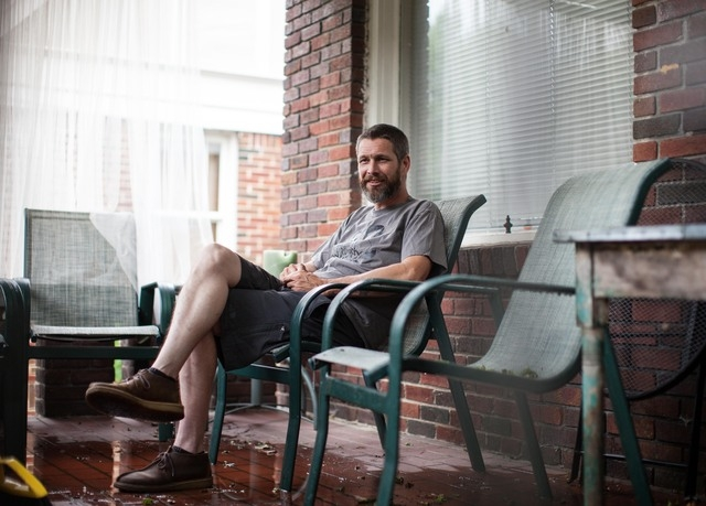 In this June 10, 2014 photo, Andy Hughes poses for a portrait at his home in Atlanta. A new study says men are more likely to get medical checkups if they're married rather than just living with a ...