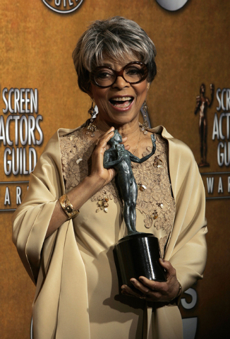 "Ruby Dee poses with the award for outstanding performance by a female actor in a supporting role for her work in ""American Gangster"" at the 14th Annual Screen Actors Guild Awards, in Los Angeles o ..."