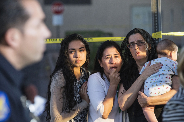 Mater Misericordiae (Mother of Mercy) Mission, church members, from left, Kirsten Duarte, her mother Theresa Duarte, and Mary Langlois, cry while listening to Phoenix Police during a news conferen ...