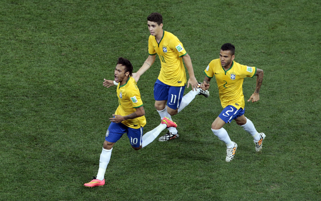 Brazil's Neymar, left, celebrates scoring his side's first goal during the group A World Cup soccer match between Brazil and Croatia, the opening game of the tournament, in the Itaquerao Stadium i ...