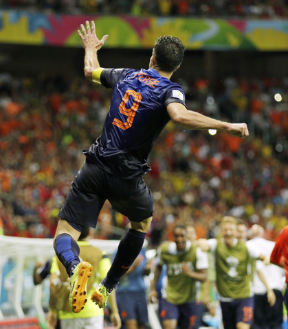 Netherlands' Robin van Persie celebrates after his scoring his side's fourth goal during the second half of the group B World Cup soccer match between Spain and the Netherlands at the Arena Ponte  ...