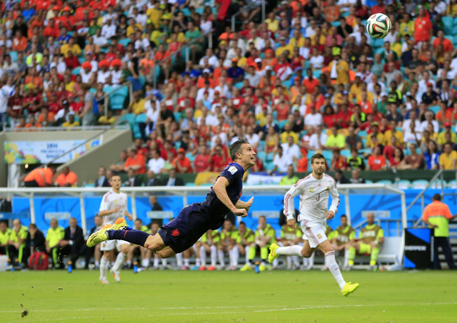 Netherlands' Robin van Persie scores a goal during the group B World Cup soccer match between Spain and the Netherlands at the Arena Ponte Nova in Salvador, Brazil, Friday, June 13, 2014. (AP Phot ...