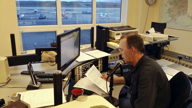 National Weather Service meteorological technician Robert Murders reads the weather at the weather service office in Nome, Alaska. (AP/KNOM, Rolland Trowbridge)