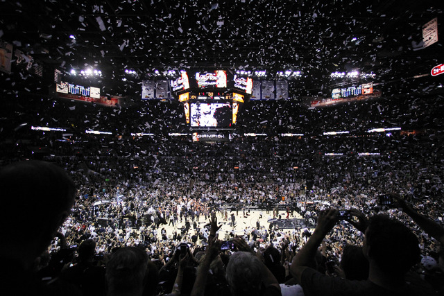 Confetti falls after Game 5 of the NBA basketball finals between the San Antonio Spurs and the Miami Heat on Sunday, June 15, 2014, in San Antonio. San Antonio won the NBA championship 104-87. (AP ...
