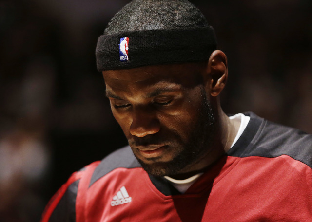 Miami Heat forward LeBron James waits for the beginning of Game 5 of the NBA basketball finals against the San Antonio Spurs on Sunday, June 15, 2014, in San Antonio. (AP Photo/David J. Phillip)