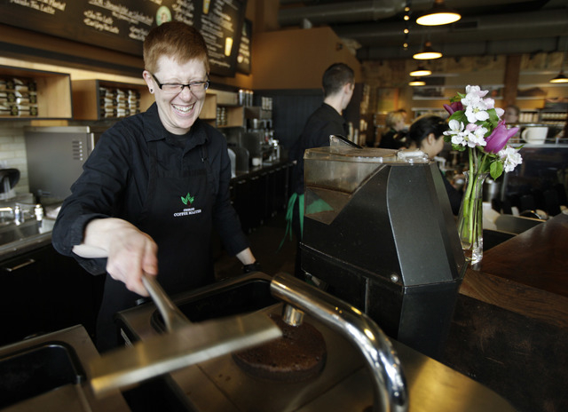 In this Friday, April 27, 2012 file photo, Starbucks barista Linsey Pringle prepares a cup of coffee at a Starbucks Corp. store in Seattle. Starbucks on Monday, June 16, 2014 announced a new partn ...