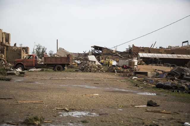 Severely damaged homes and buildings are seen after a tornado on Monday, June 16, 2014, in Pilger, Neb. The National Weather Service said at least two twisters touched down within roughly a mile o ...