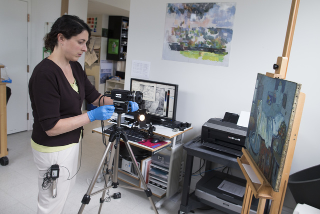 "Patricia Favero, associate conservator at The Phillips Collection, sets up an infared camera to view an image of a man found underneath one of Picasso's first masterpieces, ""The Blue Room,&qu ..."