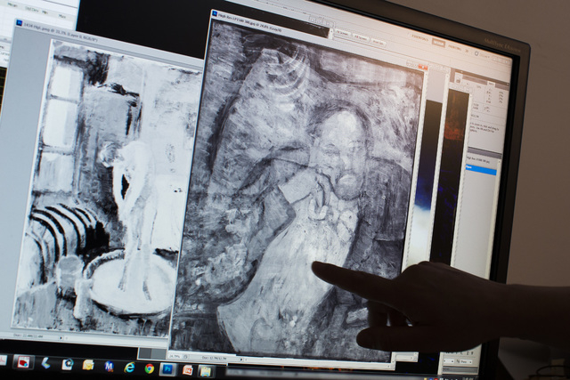 "Patricia Favero, associate conservator at The Phillips Collection, points to an image of a man found underneath one of Picasso's first masterpieces, ""The Blue Room,"" on Tuesday, June 10, ..."