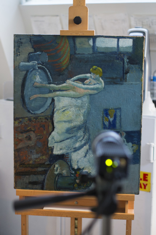 """The Blue Room,"" one of Pablo Picasso's first masterpieces sits in a vertical orientation in front of an infared camera at The Phillips Collection, on Tuesday, June 10, 2014, in Washingt ..."