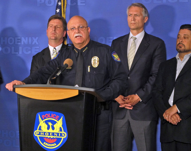 Phoenix Police Chief Daniel Garcia, second from left, speaks at a news conference announcing an arrest on Monday, June 16, 2014, in Phoenix. Police have arrested an ex-convict Gary Michael Moran,  ...