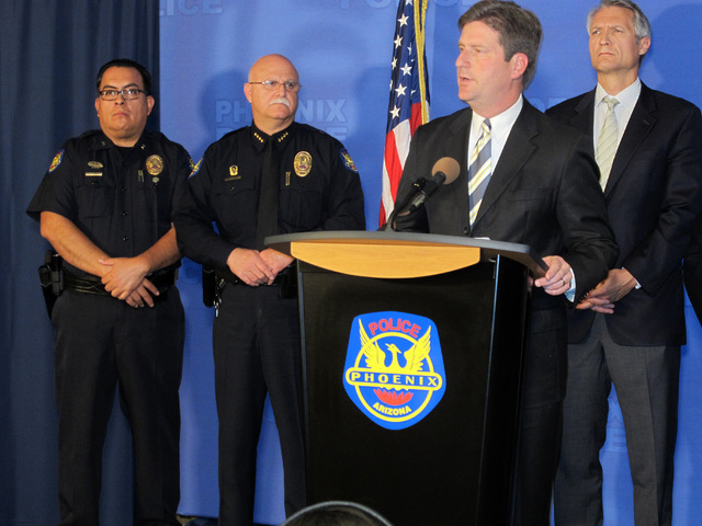 Phoenix Mayor Greg Stanton, second from right, speaks at a news conference announcing an arrest on Monday, June 16, 2014. Gary Michael Moran, 54,  an ex-convict is being held for an attack that le ...