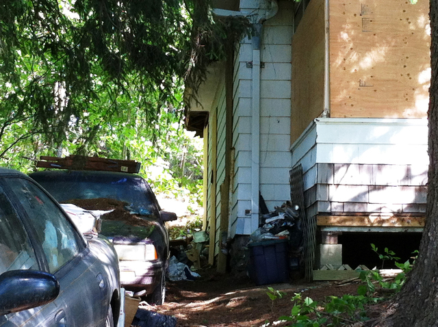 The home of Beverly Mitchell in Cheshire, Conn., is shown June 15, 2014. Mitchell, 66, described by police as an apparent hoarder, died of accidental and traumatic asphyxia after a floor piled hig ...