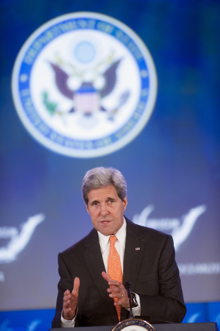 Secretary of State John Kerry addresses the second day of the State Department's 'Our Ocean' conference at the State Department in Washington, Tuesday, June 17, 2014.  President Barack Obama is lo ...