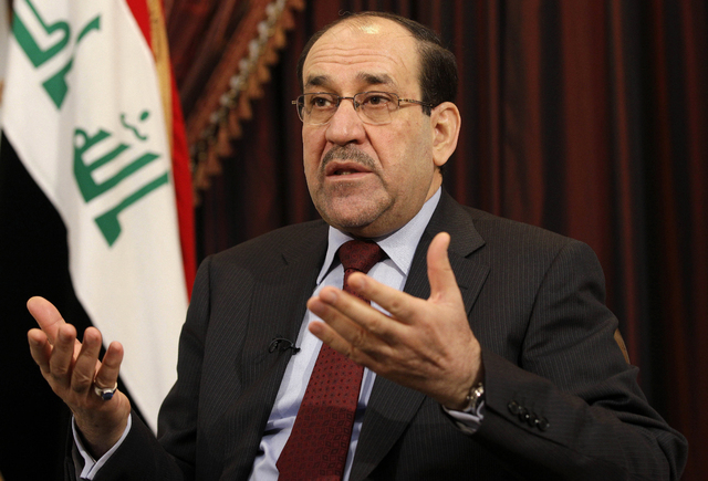 Iraq's Shiite Prime Minister Nouri al-Maliki talks during a Dec. 3, 2011, interview with The Associated Press in Baghdad, Iraq. The prospect of the U.S. military returning to the fight in Iraq has ...