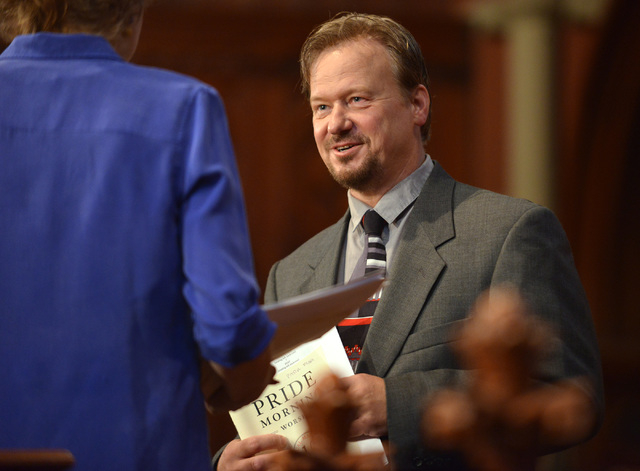 In this June 14, 2014 photo, Frank Schaefer, right, speaks with Rev. Nancy Taylor, left, before a ceremony where Schaefer received an Open Door Award for his public advocacy in Massachusetts, at O ...