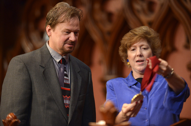 In this June 14, 2014 photo, Frank Schaefer, left. is shown the Open Door Award by Rev. Nancy Taylor, before a ceremony where Schaefer received the award for his public advocacy marking 10 years o ...